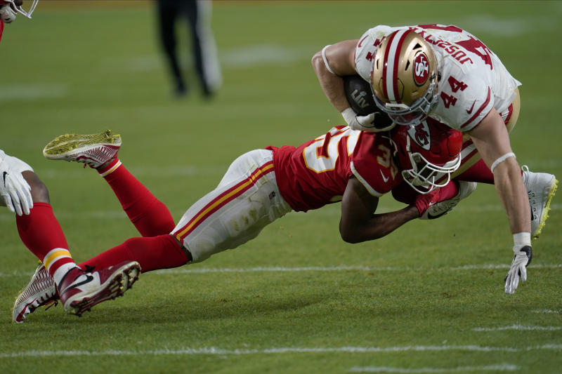 Kansas City Chiefs defensive back Charvarius Ward tackles San Francisco 49ers fullback Kyle Juszczyk during the second half of Super Bowl LIV. (AP Photo/David J. Phillip)