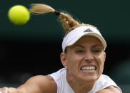 Germany's Angelique Kerber plays a return to Coco Gauff of the U.S. during the women's singles fourth round match on day seven of the Wimbledon Tennis Championships in London, Monday, July 5, 2021. (AP Photo/Kirsty Wigglesworth)