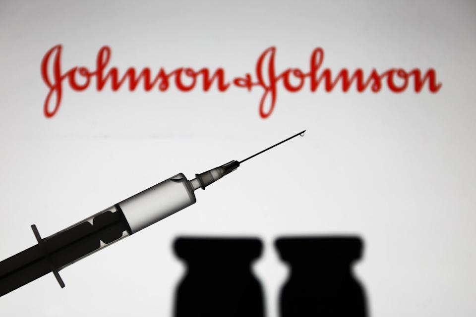 Medical syringe is seen with Johnson and Johnson company logo displayed on a screen in the background in this illustration photo taken in Poland on November 16, 2020. (Photo by Jakub Porzycki/NurPhoto via Getty Images) (Photo: NurPhoto via Getty Images)