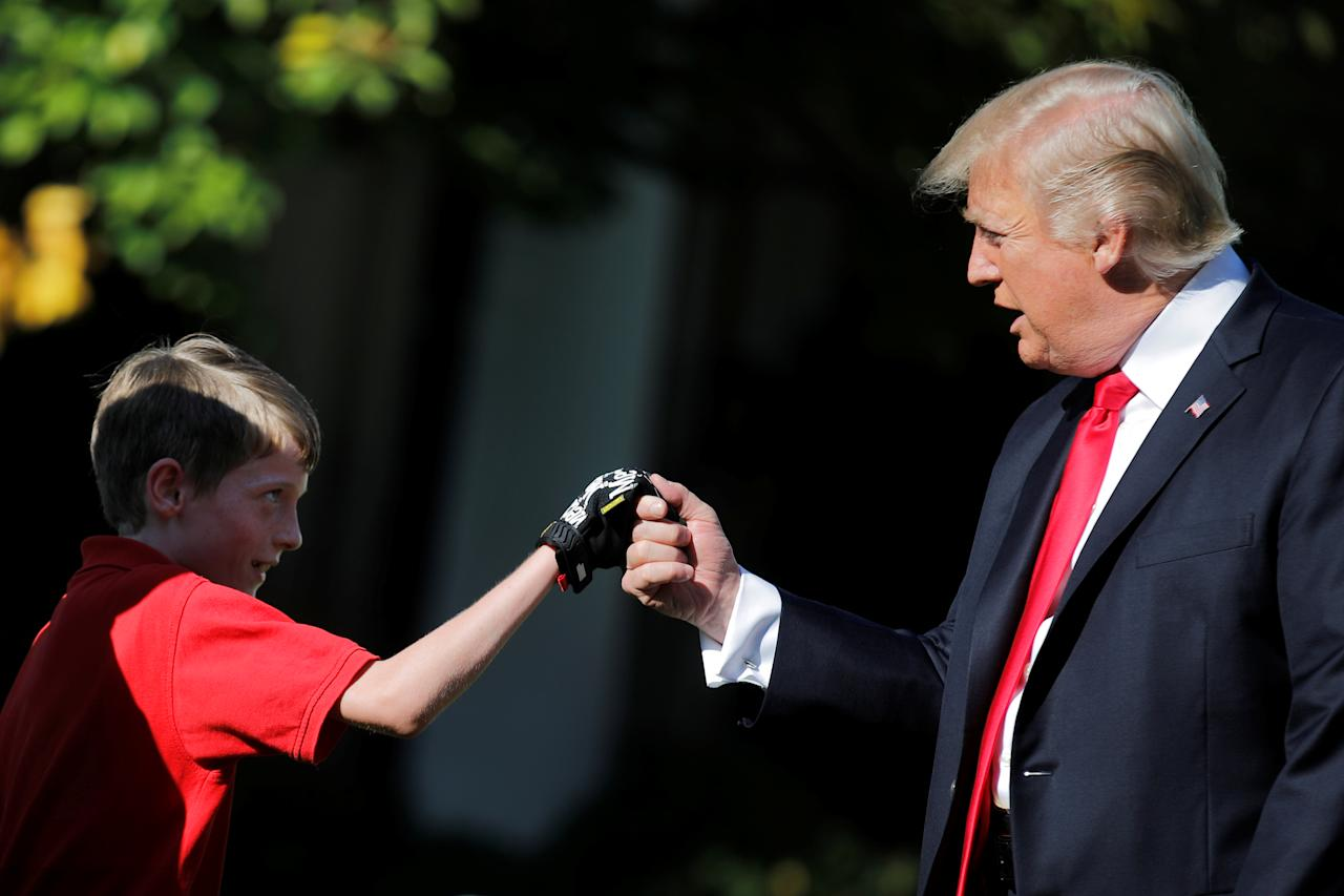 <p>President Donald Trump shakes hands with 11-years-old Frank Giaccio as he cuts the Rose Garden grass at the White House in Washington, U.S., September 15, 2017. Frank, who wrote a letter to Trump offering to mow the White House lawn, was invited to work for a day at the White House along the National Park Service staff. (Photo: Carlos Barria/Reuters) </p>