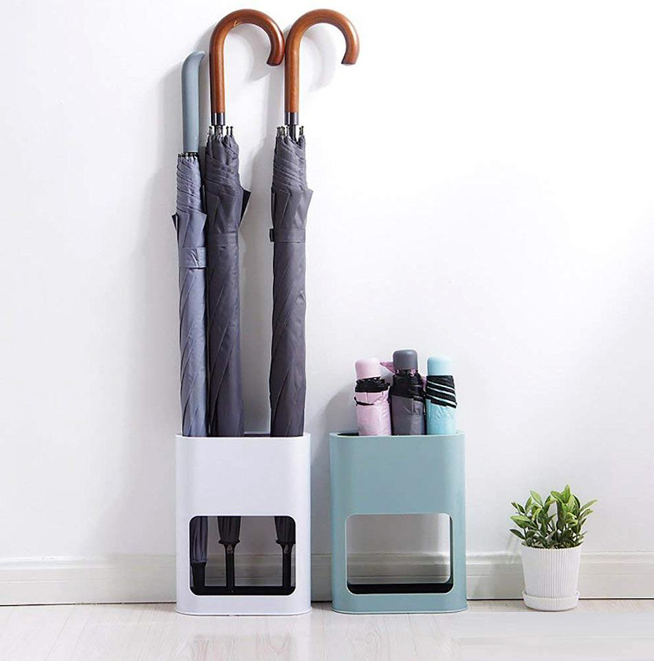 "<p>This compact, modular design is <a href=""https://www.marthastewart.com/1505992/amazing-decor-ideas-rental-apartment"">perfect for small spaces</a> and can hold up to four small umbrellas. Offered in two colorways (light blue or white), this stand also has a water tray at the bottom that can be easily removed for easy cleanup.</p> <p><strong><em>Shop Now: </em></strong><em>Lldaily Umbrella Stand, $17.99, </em><a href=""https://www.amazon.com/Lldaily-Umbrella-Holder-Indoor-Storage/dp/B07CNLP93Y/ref=as_li_ss_tl?ie=UTF8&amp;linkCode=ll1&amp;tag=msllifeumbrellastandsthatpulldoubledutyhbakerjan20-20&amp;linkId=ba029a847afaecc0f74276b6974c813f""><em>amazon.com</em></a><em>.</em></p>"