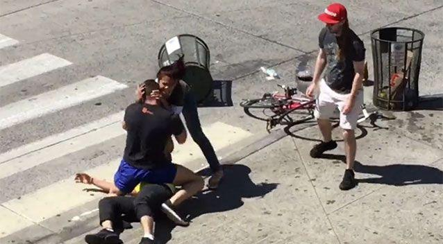 A passerby tried to help break up the fight. Source: LiveLeak