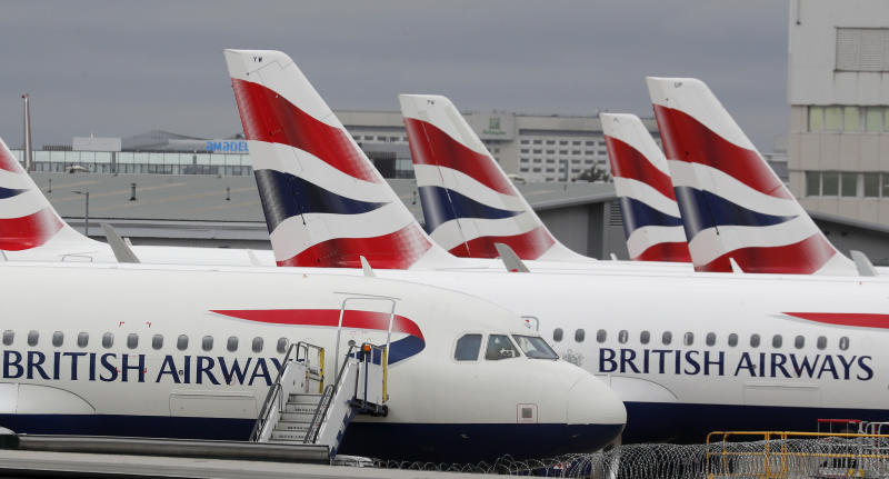 British Airways planes parked at Terminal 5 Heathrow airport in London, Wednesday, March 18, 2020. Britain's Foreign Secretary Dominic Raab has taken the decision to advise British nationals against non-essential travel globally for an initial period of 30 days, and of course subject to ongoing review. For most people, the new coronavirus causes only mild or moderate symptoms, such as fever and cough. For some, especially older adults and people with existing health problems, it can cause more severe illness, including pneumonia. (AP Photo/Frank Augstein)