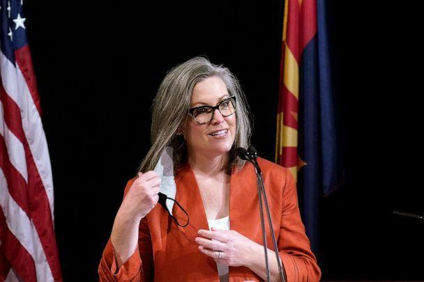 PHOTO: Arizona Secretary of State Katie Hobbs removes her face mask as she addresses the members of Arizona's Electoral College prior to them casting their votes, Dec. 14, 2020, in Phoenix. (Ross D. Franklin/AP, FILE)