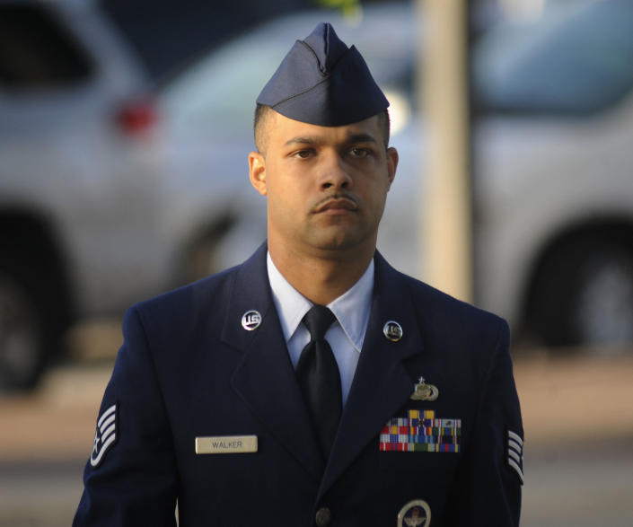 Air Force Staff Sgt. Luis Walker arrives for the fourth day of his trial at Lackland Air Force Base in San Antonio, Texas, Friday, July 20, 2012. Walker is accused of sexually assaulting 10 basic trainees, with charges ranging from rape and aggravated sexual assault to obstructing justice and violating rules of professional conduct. If convicted, he could be sentenced to life imprisonment. (AP Photo/San Antonio Express News, Billy Calzada)