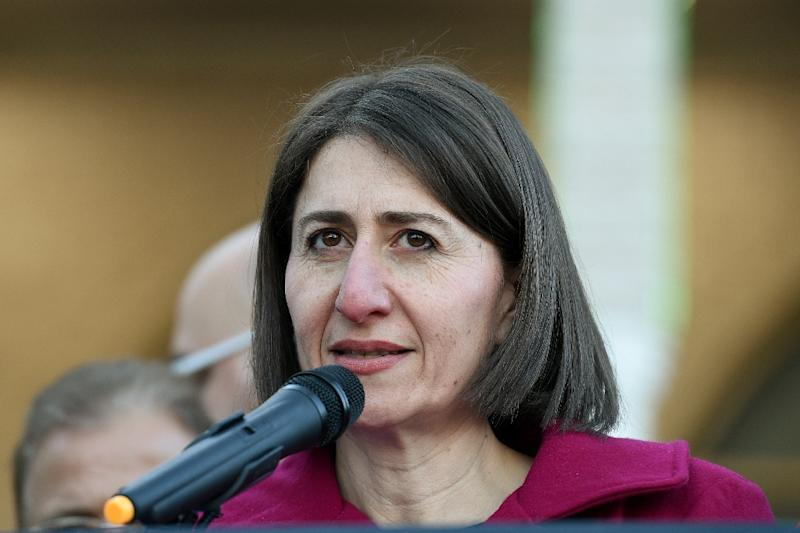 New South Wales Premier Gladys Berejiklian's (pictured June 2017) coalition lost several seats, while Labor gained two (AFP Photo/Saeed KHAN)