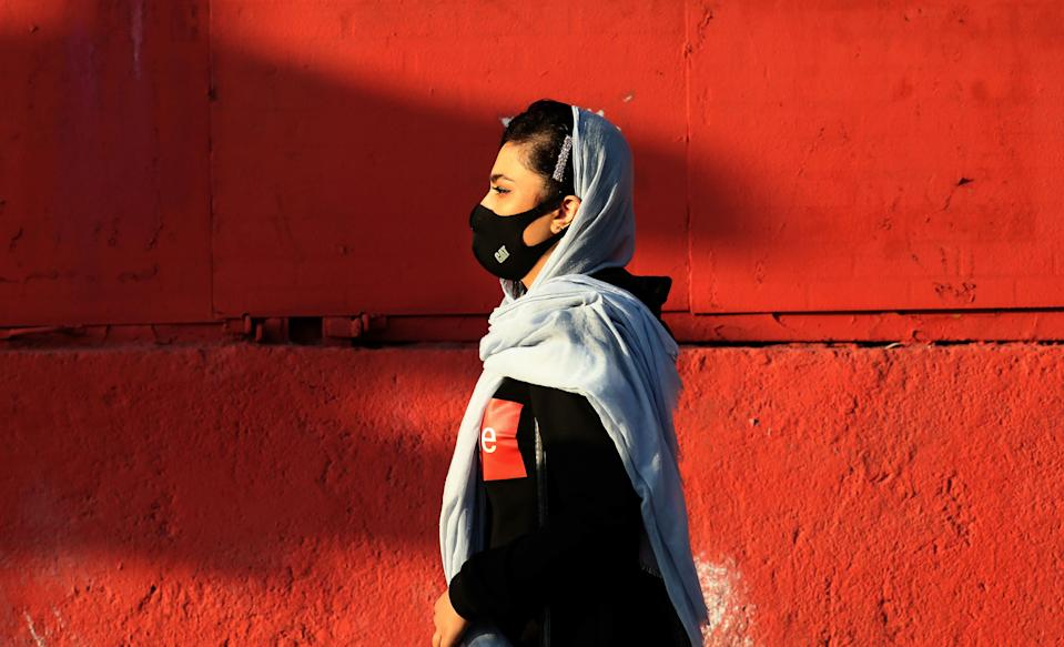 An Iranian woman wears a face mask as a Covid-19 coronavirus pandemic precaution, in Iran's capital Tehran on October 19, 2020. - Iran today announced 337 deaths from the novel coronavirus, a record high for a single day in the Middle East country hardest hit by the Covid-19 pandemic. The latest deaths brought to 30,712 the total number of fatalities since Iran reported its first coronavirus cases in February, health ministry spokeswoman Sima Sadat Lari said in televised remarks. (Photo by ATTA KENARE / AFP) (Photo by ATTA KENARE/AFP via Getty Images)