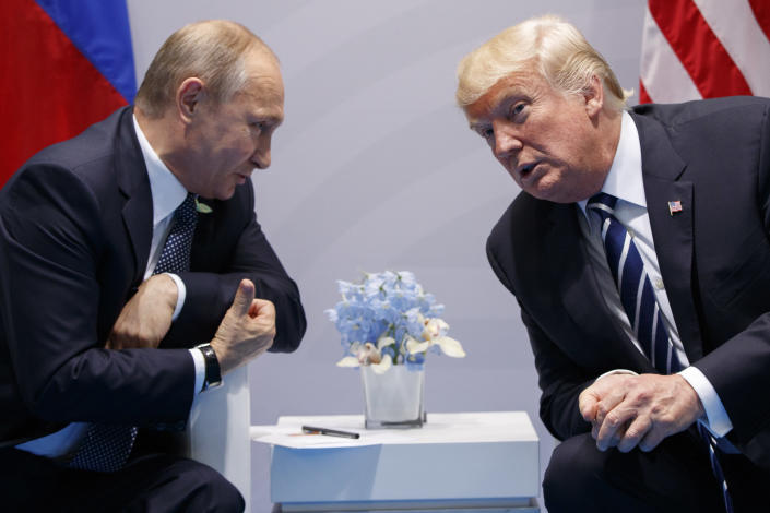 FILE - In this July 7, 2017, file photo, U.S. President Donald Trump meets with Russian President Vladimir Putin at the G-20 Summit in Hamburg. Putin won't congratulate President-elect Joe Biden until legal challenges to the U.S. election are resolved and the result is official, the Kremlin announced Monday, Nov. 9, 2020. When Donald Trump won in 2016, Putin was prompt in offering congratulations, but his spokesman Dmitry Peskov told reporters that this year's election is different. (AP Photo/Evan Vucci, File)
