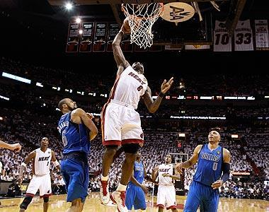 LeBron James' fourth-quarter dunk in front of Tyson Chandler helped close out the Heat's 92-84 victory over the Mavericks in Game 1 of the NBA Finals