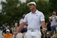 Bryson DeChambeau reacts after missing a putt on the third green in the third round at the Northern Trust golf tournament, Saturday, Aug. 21, 2021, at Liberty National Golf Course in Jersey City, N.J. (AP Photo/John Minchillo)