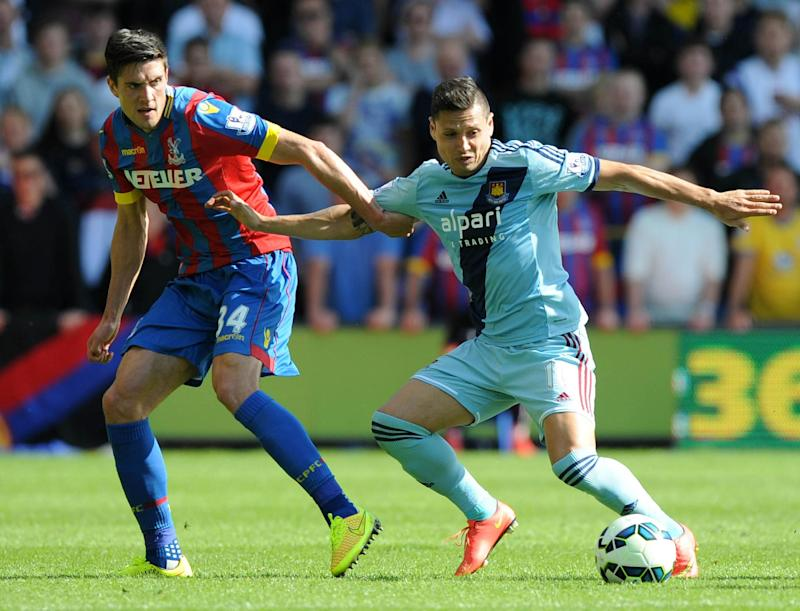 Crystal Palace's English defender Martin Kelly (L) vies with West Ham United's Argentinian striker Mauro Zarate (R) during the English Premier League football match between Crystal Palace and West Ham United at Selhurst Park on August 23, 2014