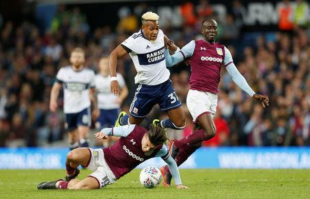 Soccer Football - Championship Play Off Semi Final Second Leg - Aston Villa v Middlesbrough - Villa Park, Birmingham, Britain - May 15, 2018 Aston Villa's Jack Grealish and Albert Adomah in action with Middlesbrough's Adama Traore Action Images via Reuters/Ed Sykes