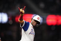 Atlanta Braves' Ronald Acuna Jr., celebrates after he hit a home run during the third inning of the team's baseball game against the Miami Marlins on Wednesday, April 14, 2021, in Atlanta. (AP Photo/Brynn Anderson)