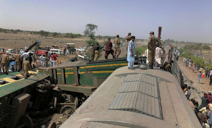 In this photo released by Pakistan's army media wing Inter Services Public Relations, troops and rescuers work at the site of a train collision in Ghotki district in the southern Pakistan, Monday, June 7, 2021. Two express trains collided in southern Pakistan early Monday, killing dozens of passengers, authorities said, as rescuers and villagers worked to pull injured people and more bodies from the wreckage. (Inter Services Public Relations vis AP)