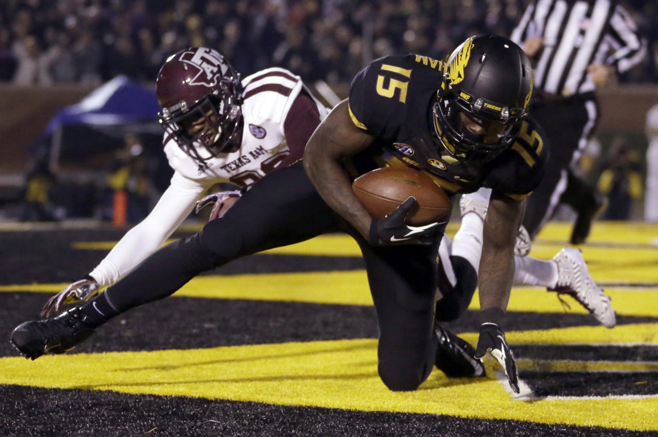 Missouri wide receiver Dorial Green-Beckham, front, falls in the end zone after catching a 38-yard touchdown pass as Texas A&M defensive back Deshazor Everett defends during the second quarter of an NCAA college football game on Saturday, Nov. 30, 2013, in Columbia, Mo. (AP Photo/Jeff Roberson)