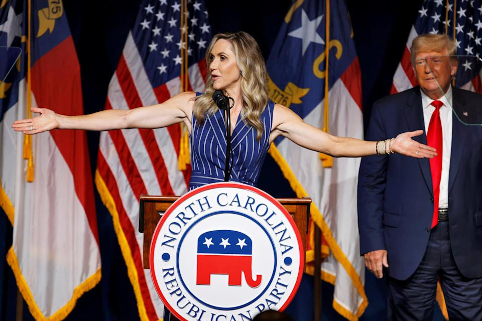 Lara Trump addresses the audience as her father-in-law, former U.S. President Donald Trump, looks on at the North Carolina GOP convention dinner in Greenville, North Carolina (REUTERS)