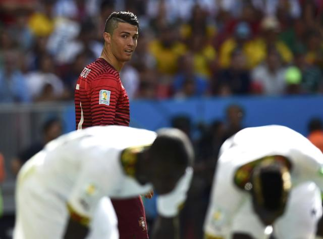 Portugal's Cristiano Ronaldo looks on during their 2014 World Cup Group G soccer match against Ghana at the Brasilia national stadium in Brasilia June 26, 2014. REUTERS/Dylan Martinez (BRAZIL - Tags: SOCCER SPORT WORLD CUP)