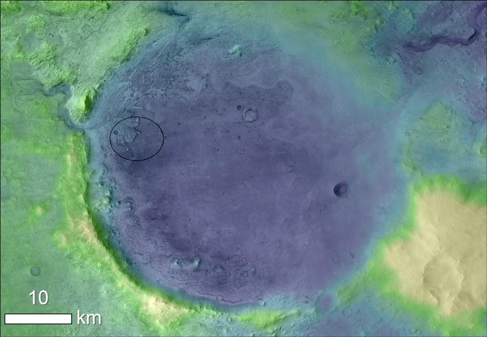 This elevation map of Jezero Crater on Mars shows the site in a rainbow of colors, with lighter colors representing higher elevation. This Martian crater is the chosen landing site for NASA's Perseverance rover, previously known as the Mars 2020 rover, which is set to launch to the Red Planet this summer.