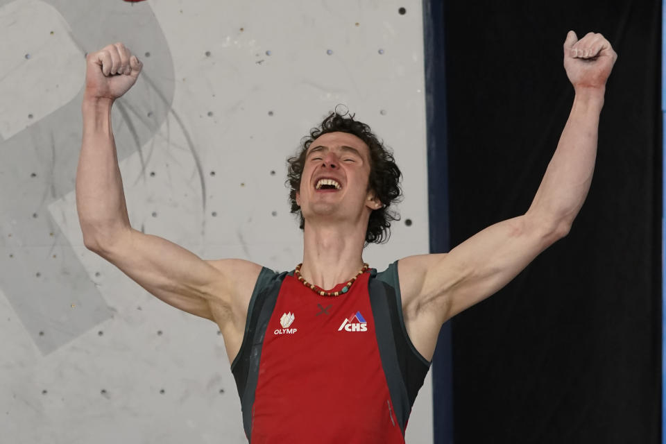 FILE - First-place finisher Adam Ondra, of the Czech Republic, celebrates after the men's boulder finals at the climbing World Cup in Salt Lake City, in this May 22, 2021, file photo Climbing has always been a niche sport among outdoor enthusiasts. Inclusion in the 2021 Tokyo Olympics will take it mainstream and the world will see just how difficult it is clinging to tiny hand holds with fingers and toes. (AP Photo/Rick Bowmer, File)