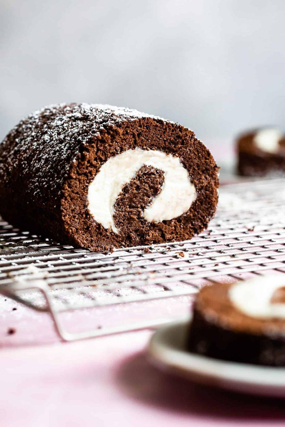 """<p>A fabulous winter dessert that's surprisingly easy to make, but perfect for a crowd.</p><p><a href=""""https://www.snixykitchen.com/chocolate-gluten-free-swiss-roll-cake/"""" rel=""""nofollow noopener"""" target=""""_blank"""" data-ylk=""""slk:Get the recipe"""" class=""""link rapid-noclick-resp"""">Get the recipe</a>.</p>"""