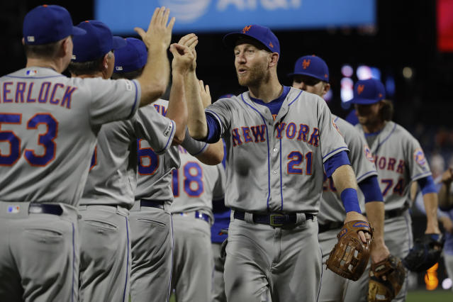 New York Mets' Todd Frazier (21) and teammates celebrate after a baseball game against the Philadelphia Phillies, Friday, Aug. 30, 2019, in Philadelphia. (AP Photo/Matt Rourke)