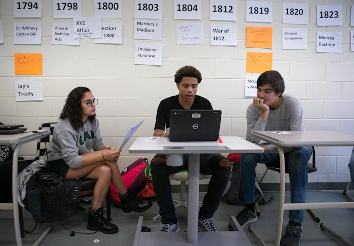 From left, Keona Barnwell, 17, Jaquan Harris, 17, and Preston Walker, 18, study impeachment Wednesday, November 20, 2019 at Powhatan High School in Powhatan, Virginia.