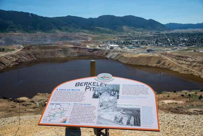 The Berkeley Pit is one of the largest Superfund sites. It is a mile-long toxic lake of heavy metals and contaminatedwater from old copper mine shafts in Butte, Montana. (Photo: William Campbell via Getty Images)