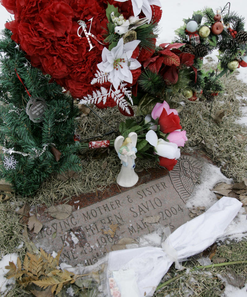 FILE - In this Feb. 22, 2008 file photo, flowers and a small angel statue surround the grave marker of Kathleen Savio, the third wife of former Bolingbrook, Ill., police officer Drew Peterson, at the Queen of Heaven Cemetery in Hillside, Ill. Originally ruled an accident, her death was later changed to a homicide. Peterson was charged with her murder in May 2009. Jury selection in his trial begins Monday, July 23, 2012, at the Will County Courthouse in Joliet, Ill. (AP Photo/Charles Rex Arbogast, File)