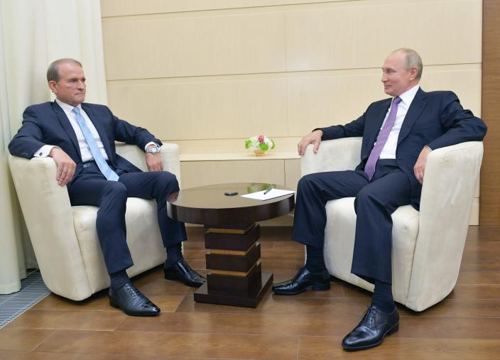 Ukrainian tycoon Viktor Medvedchuk, left, speaks to Russian President Vladimir Putin during a meeting at the Novo-Ogaryovo residence outside Moscow, Russia, Tuesday, Oct. 6, 2020. Medvedchuk, who heads the Opposition Platform for Life party and has close ties with Putin, was placed under house arrest on Thursday, May 13, 2021 by a Ukrainian court on treason charges that he denied(Sputnik, Kremlin Pool Photo via AP)