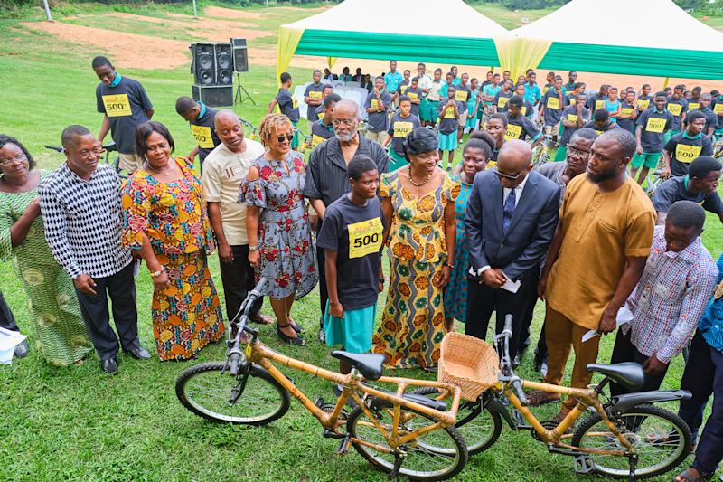 "ABCF's ""500th Bicycle"" event speakers present bamboo bicycles to individual students, recently, in Accra. Speakers included: Mr Daniel Lawer Agudey, head teacher, Ningo Senior High School (Second from left); Ms Beatrix Ollenu, Ningo-Prampram School District Director of Education (third from left); Mr Peter Djan, Head teacher, Prampram Senior High School (fourth from left); Ms Patricia Marshall Harris, executive director, ABCF (fifth from left); Mr A.Bruce Crawley, chairman, ABCF (sixth from left); Hon. Elizabeth K. T. Sackey, Deputy Regional Minister, Greater Accra (center); and Mr. Carl Nelson, COO, Ghana Investment Promotion Centre (third from right), with bamboo bicycle recipient."