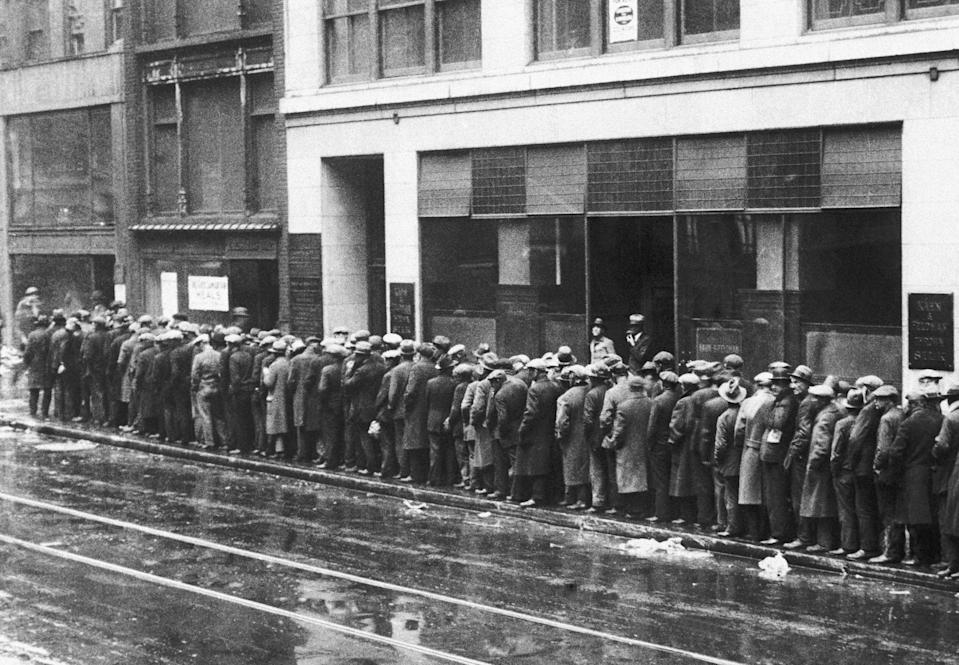 Unemployed men wait in long lines for bread and handouts during the Great Depression. By 1932, one in every three New Yorkers was unemployed, and about 1.6 million were on some form of relief.