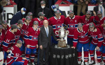 Montreal Canadiens pose with the Clarence Campbell trophy after defeating the Vegas Golden Knights to advance to the Stanley Cup finals following overtime in Game 6 of an NHL hockey Stanley Cup semifinal playoff series Thursday, June 24, 2021 in Montreal. (Ryan Remiorz/The Canadian Press via AP)