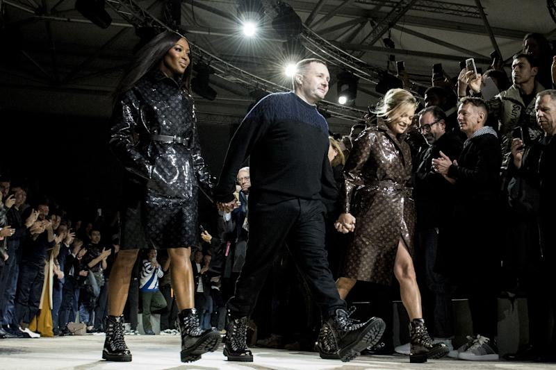 Naomi Campbell and Kate Moss reuniting on the runway of the Louis Vuitton fall/winter 2018 men's show with Kim Jones, in honor of his final collection for the house, during Paris Fashion Week in 2018. Photo courtesy of Getty Images.