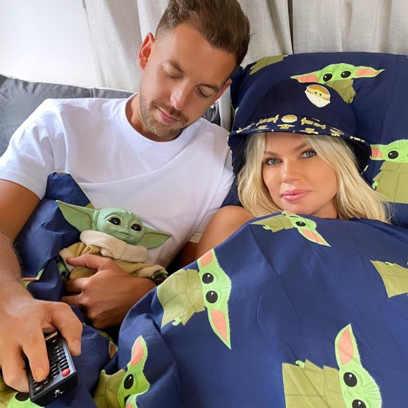 Joshua Gross and Sophie Monk in bed