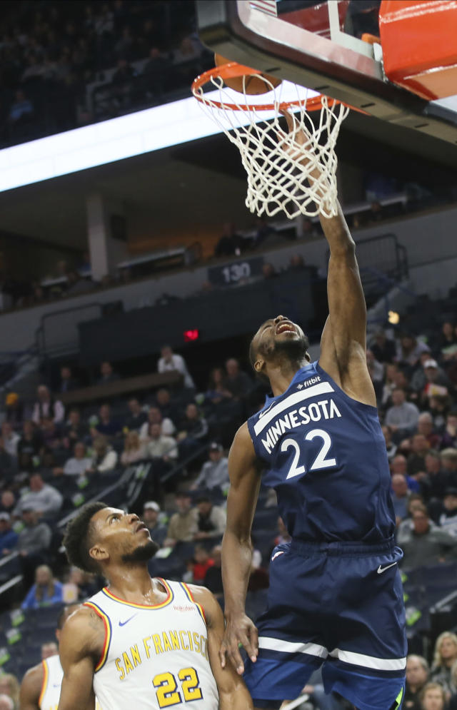 Minnesota Timberwolves' Andrew Wiggins, right, lays up a shot under the watch of Golden State Warriors' Glenn Robinson III in the first half of an NBA basketball game Friday, Nov 8, 2019, in Minneapolis. (AP Photo/Jim Mone)