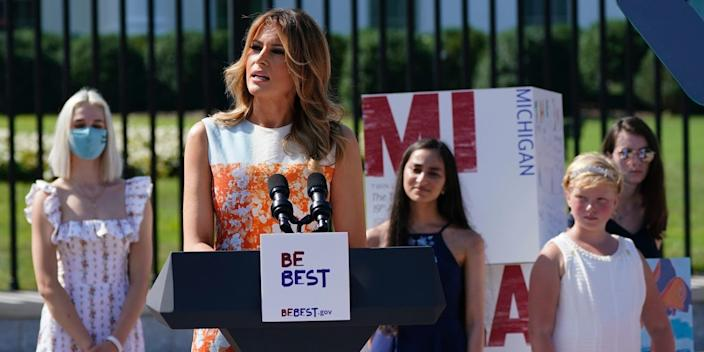 First lady Melania Trump speaks as she visits an exhibit of artwork by young Americans in celebration of the 100th anniversary of the 19th amendment.
