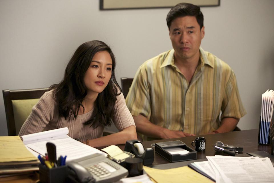 Constance Wu and Randall Park as the parents in the series in an office
