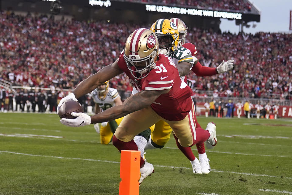 Superman: San Francisco 49ers running back Raheem Mostert leaps for the pylon to score in the second quarter of the NFC title game. (AP/Tony Avelar)