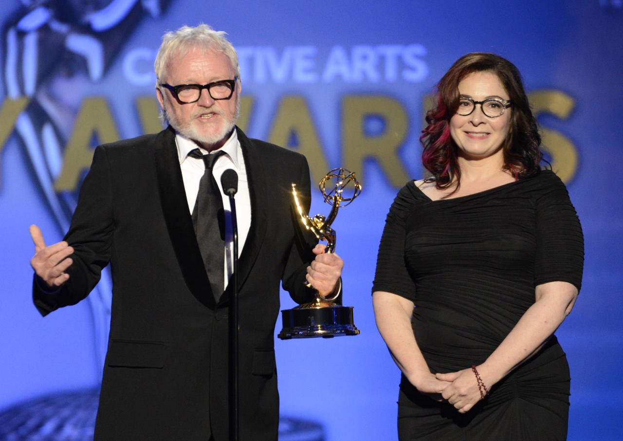 From left, Bill Groon and Carol Silverman accept the award for Outstanding Art Direction For A Single-Camera Series for Boardwalk Empire onstage at the 2013 Primetime Creative Arts Emmy Awards, on Sunday, September 15, 2013 at Nokia Theatre L.A. Live, in Los Angeles, Calif. (Photo by Phil McCarten/Invision for Academy of Television Arts & Sciences/AP Images)