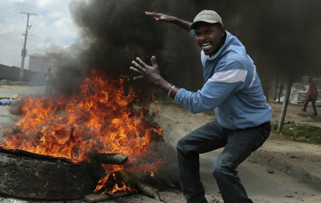 <p>An opposition supporter gestures at a barricade during clashes with police in the Jacaranda grounds quarter in Nairobi, Kenya, Tuesday, Nov. 28, 2017. (Photo: Brian Inganga/AP) </p>