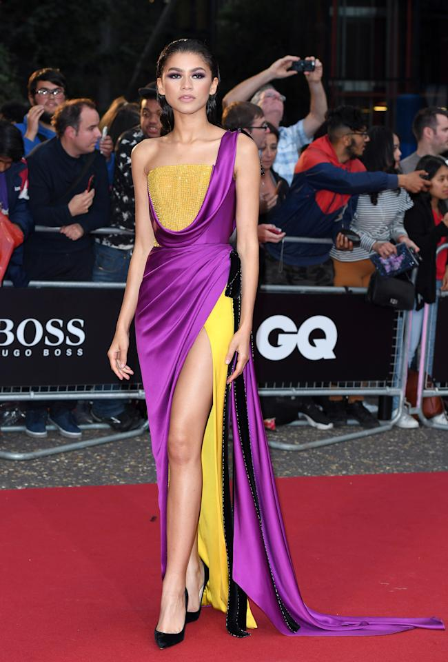 <p><strong>Wearing:</strong> A yellow and saccharine purple gown by Ralph & Russo. <br />[Photo: Getty] </p>