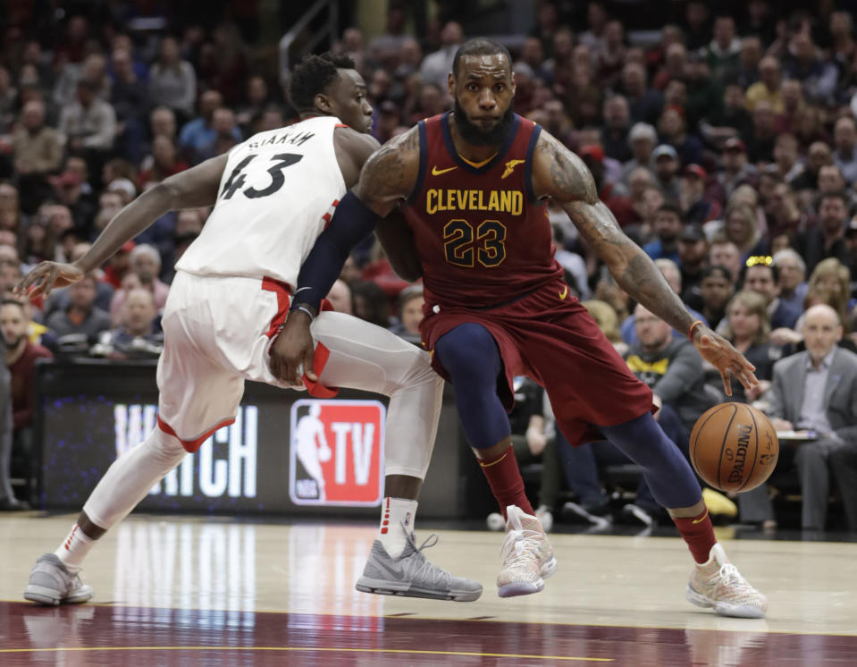 LeBron James spins past Raptors forward Pascal Siakam on his way to the basket. (AP)