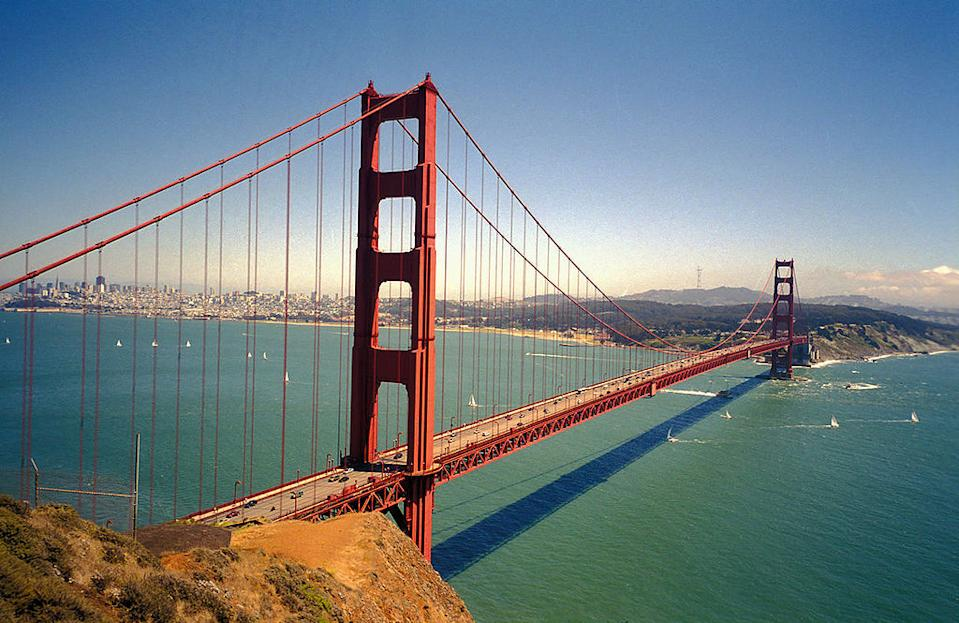 """<p><b>9. Golden Gate Bridge</b></p> <br><p>The Golden Gate Bridge is a suspension bridge spanning the Golden Gate, the opening of the San Francisco Bay into the Pacific Ocean. It has been declared one of the modern Wonders of the World by the American Society of Civil Engineers. The Frommers travel guide considers the Golden Gate Bridge """"possibly the most beautiful, certainly the most photographed, bridge in the world"""".</p> <br><p>By Aslak Raanes from Trondheim, Norway (Flickr) [CC-BY-2.0 (http://creativecommons.org/licenses/by/2.0)] via Wikimedia Commons</p>"""