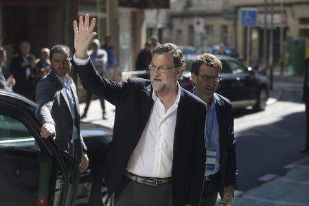 Spain's acting Prime Minister Mariano Rajoy arrives at the Popular Party's provincial congress in Pontevedra, Spain March 13, 2016. REUTERS/Miguel Vidal