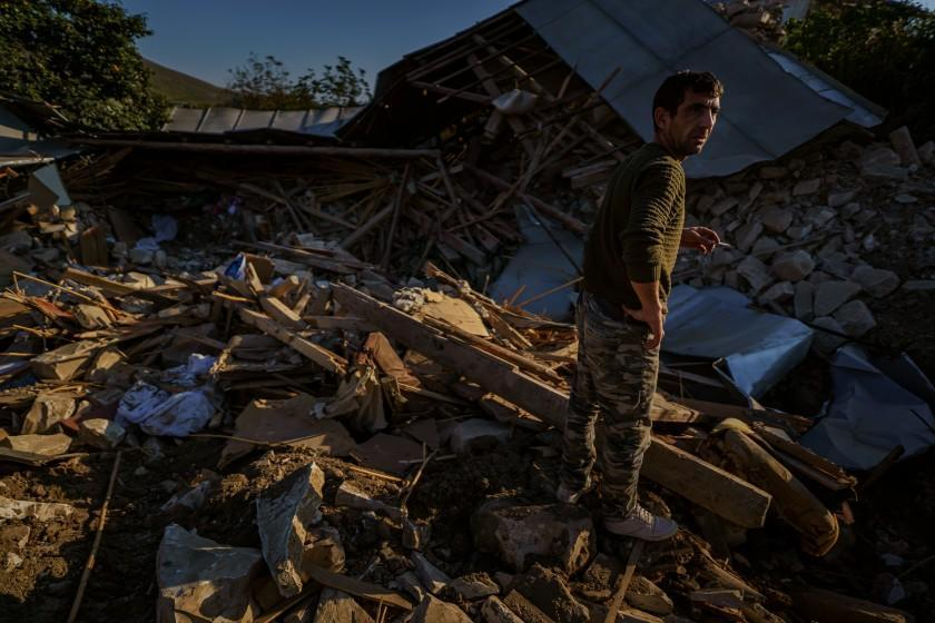 A man looks over a wreckage of a home destroyed by a military strike in Martuni, Nagorno-Karabakh.