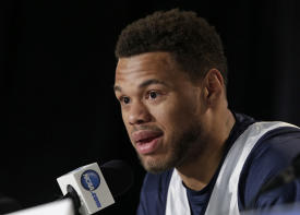 Justin Anderson answers a question during the NCAA tournament. (AP)