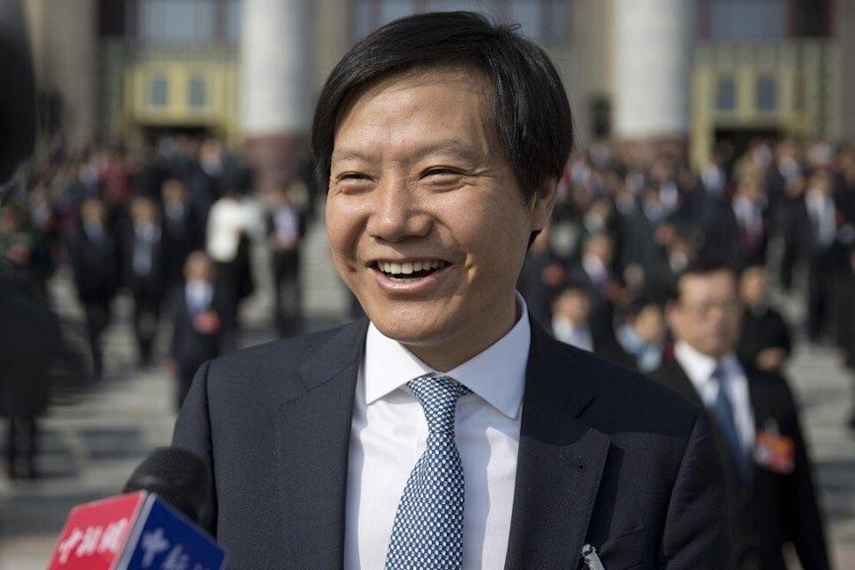 Xiaomi founder and CEO Lei Jun speaks with journalists as he leaves a meeting one day ahead of the opening session of China's National People's Congress (NPC) at the Great Hall of the People in Beijing on March 4, 2019. Photo: AP