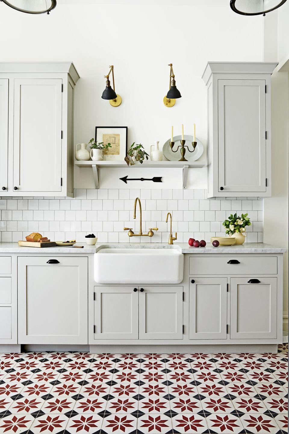 "<p>Rugs, however durable, aren't practical for a heavy-use kitchen. Enter statement floor tile. It's a more subtle way to add impact than, say, a bold eye-level backsplash.</p><p><strong>Bonus idea: </strong>Tired of the same old subway tile? This on-trend square shape has a charming shingle-like effect. </p><p><a class=""link rapid-noclick-resp"" href=""https://go.redirectingat.com?id=74968X1596630&url=https%3A%2F%2Fwww.homedepot.com%2Fp%2FMSI-Calypso-Blanco-Lotus-Pattern-12-in-x-12-in-x-10-mm-Marble-Mesh-Mounted-Mosaic-Tile-10-sq-ft-case-CALPBLA-MF10MM%2F206527637%3Fkeyword%3Dpattern%2Bfloor%2Btile%26semanticToken%3Dd0110003011_20200122122034896891_9s75%2Bd0110003011%2B%253E%2B%2Bcnn%253A%257B12%253A1%257D%2Bcnr%253A%257B7%253A0%257D%2Bcnd%253A%257B4%253A0%257D%2Bcne%253A%257B8%253A0%257D%2Bcnb%253A%257B9%253A1%257D%2Bcns%253A%257B5%253A0%257D%2Bcnx%253A%257B3%253A0%257D%2Bst%253A%257Bpattern%2Bfloor%2Btile%257D%253Ast%2Boos%253A%257B0%253A1%257D%2Bpt%253A%257Bfloor%2Btile%257D%253Apt%2Bdln%253A%257B570831%257D%2Bqu%253A%257Bpattern%2Bfloor%2Btile%257D%253Aqu&sref=https%3A%2F%2Fwww.countryliving.com%2Fhome-design%2Fdecorating-ideas%2Fg3988%2Fkitchen-trends%2F"" rel=""nofollow noopener"" target=""_blank"" data-ylk=""slk:SHOP PATTERNED TILE"">SHOP PATTERNED TILE</a></p>"