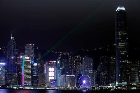 FILE PHOTO: Laser light beams as buildings in the financial Central district are lit up before Earth Hour in Hong Kong, China March 25, 2017.  REUTERS/Bobby Yip