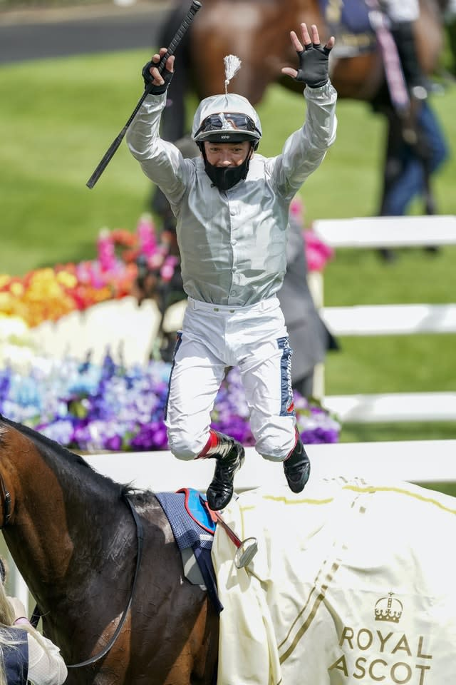 Frankie Dettori leaps from Palace Pier after completing a double in the St James's Palace Stakes at Royal Ascot (Alan Crowhurst/PA)